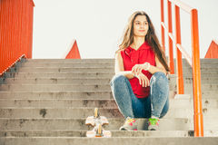 Skate girl on stairs with skateboard. Stock Photo