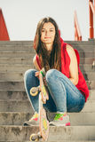 Skate girl on stairs with skateboard. Royalty Free Stock Photography