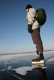 Skate on lake. Men skating on frozen surface of lake Stock Photos