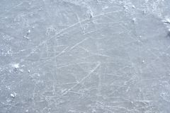 Skate marks on the surface of an outdoor ice rink Stock Photos