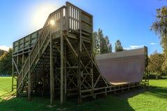 Large half-pipe skate ramp and sunburst stock photos