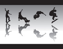 Skate Silhouettes III. Skater silhouettes performing various tricks. One is nosegrinding, 5-0 grinding, grab and one is kickflipping Stock Photo