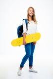 Skateboard εκμετάλλευσης γυναικών σπουδαστών Στοκ φωτογραφία με δικαίωμα ελεύθερης χρήσης