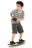skateboard παικτών παιχνιδιών παιδιώ&n Στοκ Φωτογραφίες