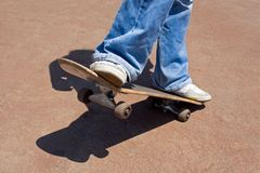 Skateboard. Driving on a skateboard on asphalt Royalty Free Stock Photography