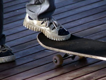 Skateboard. A boy stands with one foot on his skateboard royalty free stock images