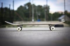 Skateboard. Lying on the asphalt Stock Images
