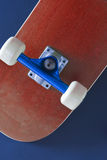 Skateboard. The underside of a red coloured skateboard on a blue background Stock Photography