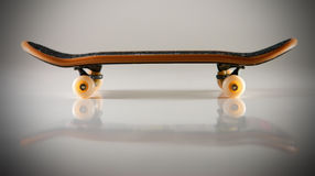 Skateboard. Macro of fingerboard on light background with reflection Stock Photo