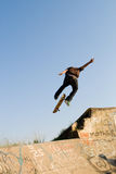 Skateboard. Young teen boy playing skateboard and doing a high jump Royalty Free Stock Photography