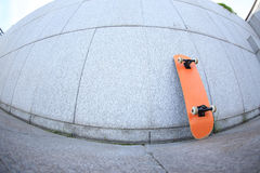Skateboard against wall Stock Photo