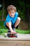Skateboard boy. Five year old boy on a skateboard outdoors Stock Photo