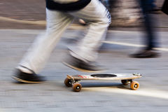 With the skateboard in the city Royalty Free Stock Photos