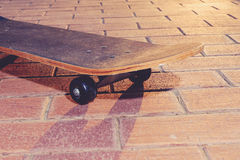 Skateboard closeup. Vinatge skate board backlit Royalty Free Stock Photography