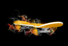 Skateboard in the colored smoke Stock Images