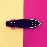 Skateboard on colorful background. Royalty Free Stock Image