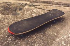 Skateboard on concrete flooring Royalty Free Stock Photo