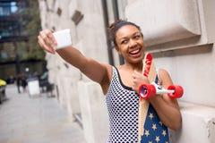 Skateboard girl taking a selfie stock photo