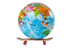 Skateboard and globe on white background Stock Photo