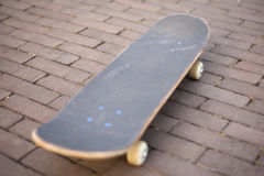 Skateboard on the ground Royalty Free Stock Image
