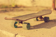 Skateboard on ground Stock Images