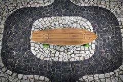 Skateboard on Ipanema mosaic stock photo