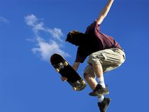 Skateboard jump #3. Skateboarder jumping a ramp Royalty Free Stock Photography