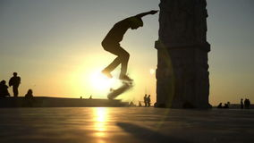 Skateboard jump. Skateboarding silhouette person jumping. Artificial slow motion footage