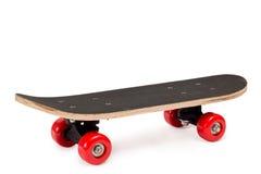 Skateboard med röda hjul Royaltyfri Foto