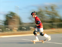 Skateboard Motion. Shot of a boy on a skateboard using a panning motion to blur it stock photography