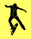 Skateboard music. Silhouette of a boy using an mp3 music player jumping off his skateboard. Bright colored background. Clipping path can be easily performed on Royalty Free Stock Images