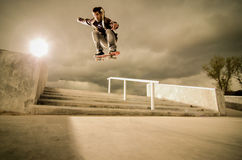 Skateboard ollie. Skateboarder jumping over the stairs on a big ollie Stock Photography