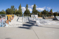 Skateboard park. A skateboard park with several ramps and jumps, many covered with colorful graffiti Stock Photography