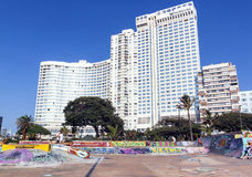 Skateboard Park with Luxury Hotels in Background Royalty Free Stock Photography