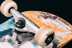 Skateboard parts on black background Stock Images