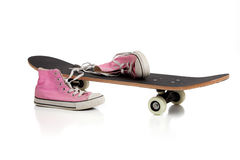 Skateboard and pink Sneakers Stock Photography