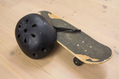 Skateboard and protective helmet Stock Image