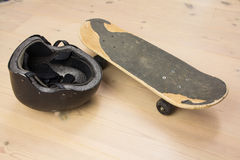 Skateboard and protective helmet Royalty Free Stock Image