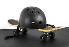 Skateboard and protective helmet Stock Photos