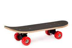 Skateboard with red wheels. On white background Royalty Free Stock Photo
