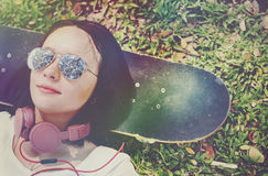 Skateboard Relaxation Rest Lying Chill Headphone Concept Stock Photography