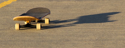 Skateboard and shadow Royalty Free Stock Images
