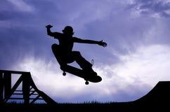 Skateboard silhouette at sunset Stock Image
