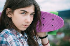 Skateboard sport hobby. Summer activity. Urban scene, city life. plastic mini cruiser board. Spring. ready to ride on. The street. Hipster girl with penny board stock images