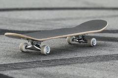 Skateboard. Is standing on asphalt with tire tracks royalty free stock image