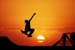 Skateboard at sunset Stock Image