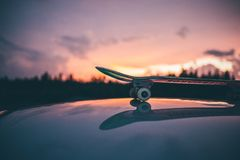 Skateboard on Top of Car in Selective Focus Photography Stock Images
