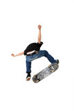 Skateboard trick. Skateboarder doing a kickflip with his board, Shot in studio and isolated on white with some motion blur Royalty Free Stock Photography