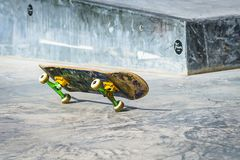 Skateboard on two wheels Stock Images