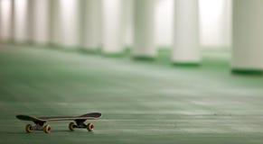 Skateboard in an underground parking Stock Photo